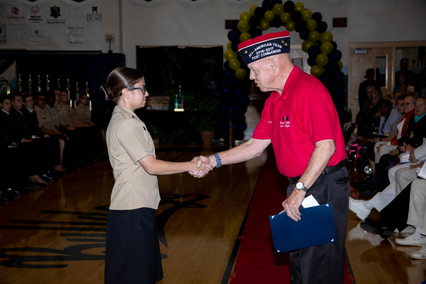 Post 12093 Past District 5 Commander Fred Herr presents Centennial HS JROTC Cadet of the Year Haley Hudson with the VFW JROTC Award.