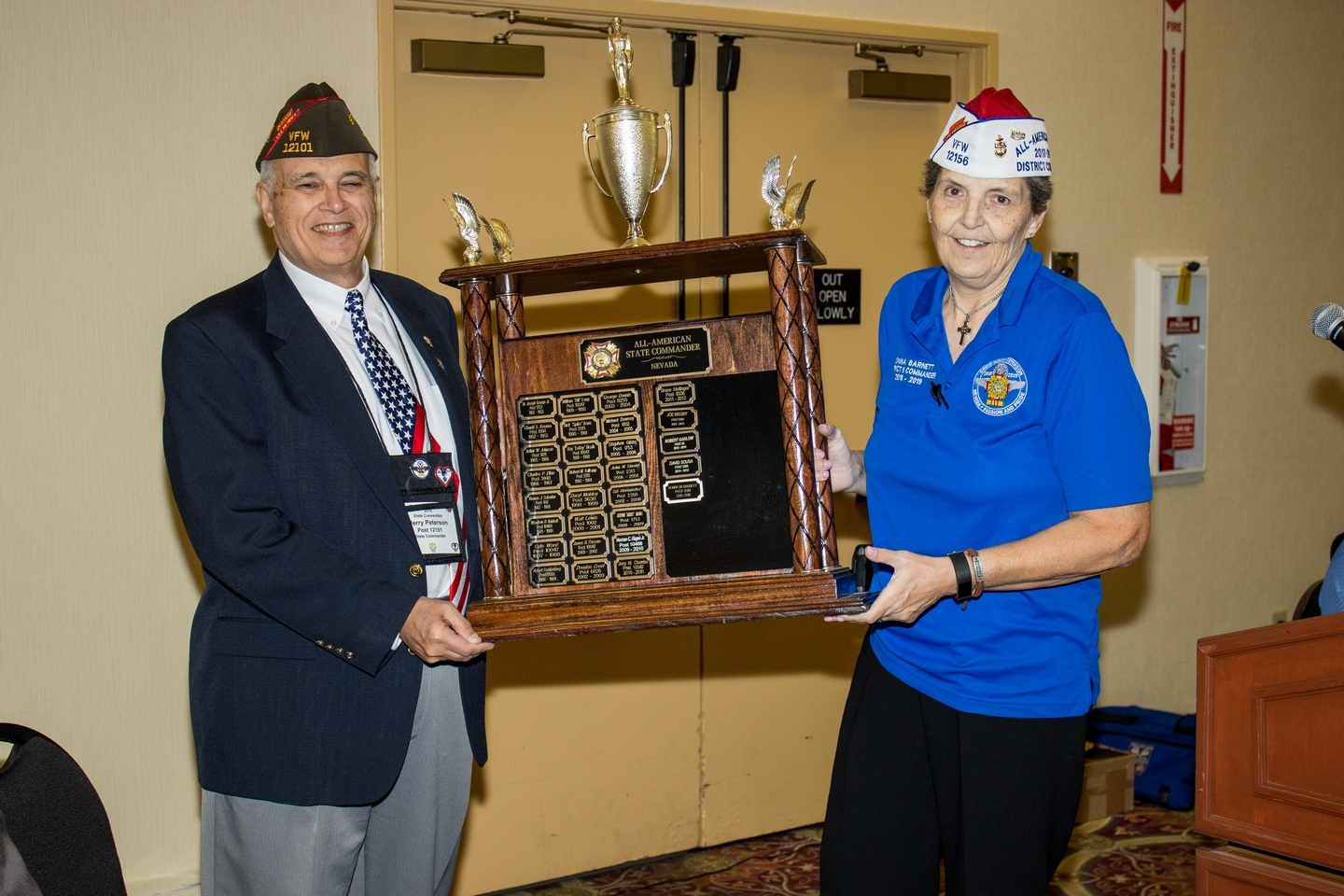 Past State Commander Donna Barnett presenting the award to outgoing State Commander Jerry Peterson