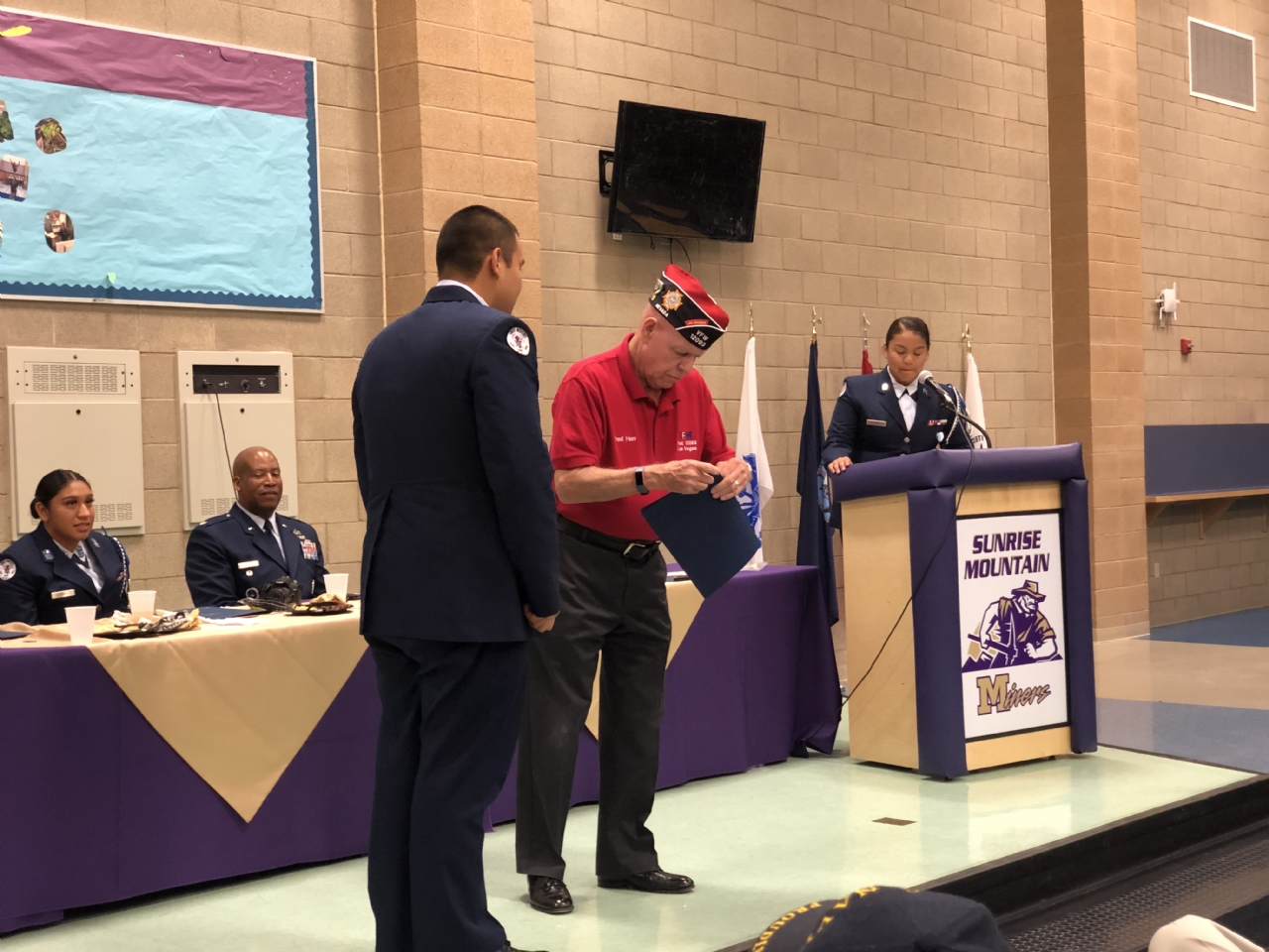 Past District Commander Fred Herr presents JROTC Cadet of the Year Jesus Castillo with the VFW JROTC Cadet of the Year award.